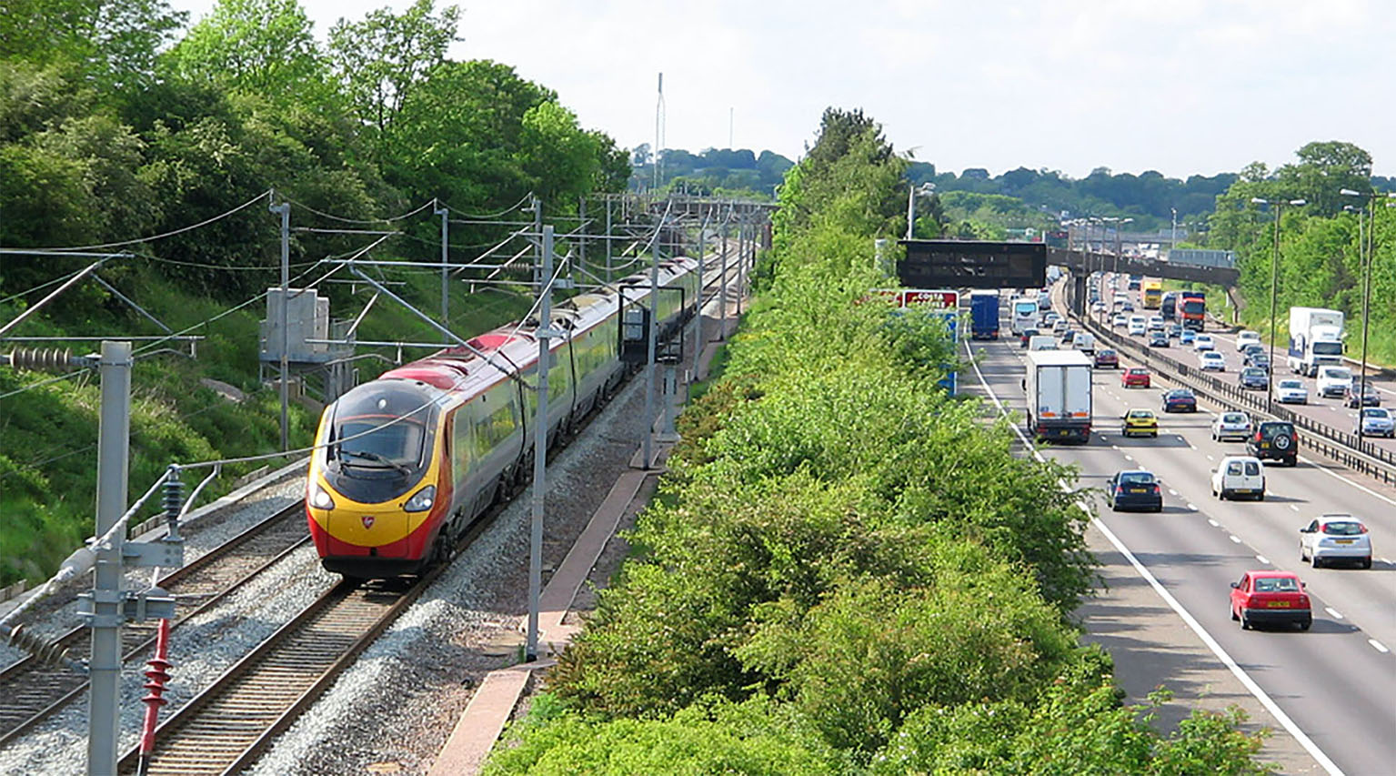 Railway line and motorway running side by side